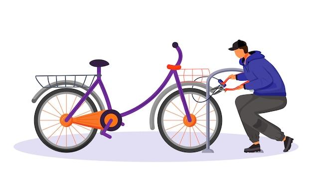 Facet kradnący rower przymocowany do stojaka na rower bez twarzy, bez twarzy