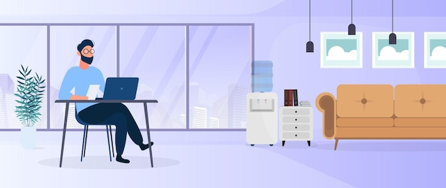 Facet pracuje na laptopie w stylowym biurze. gabinet, komputer, sofa, szafa, regał z książkami, obrazy na ścianie. praca w domu. .