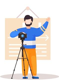 Facet stojący z aparatem i statywem