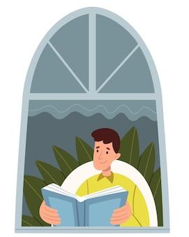 Facet w jasnych ubraniach czyta przed oknem.