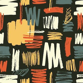 Fajny wzór z żółtymi, czerwonymi, niebieskimi pociągnięciami pędzla na czarnej powierzchni