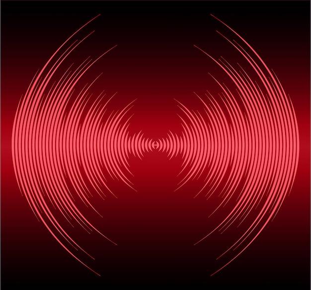 Fale dźwiękowe oscylujące na ciemno czerwonym tle światła
