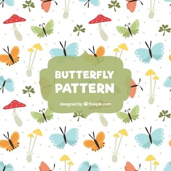 Fantastyczny wzór z motyli i grzybami