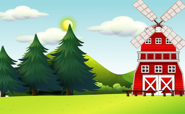 Farma w scenerii przyrody z wiatrakiem i dużymi sosnami