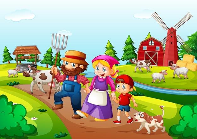 Farma z czerwoną stodołą i wiatrakiem