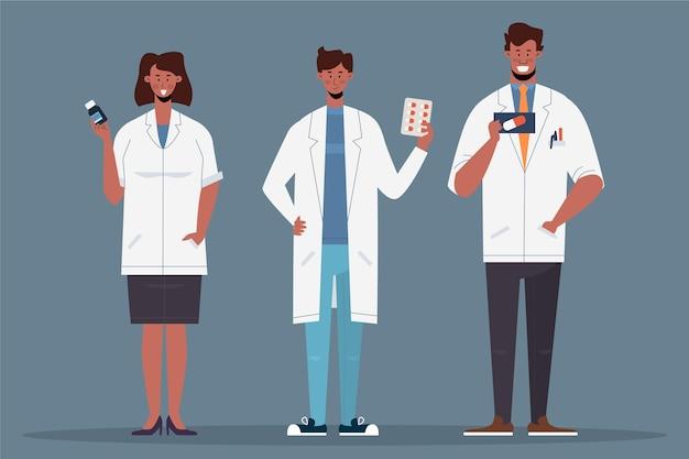 Farmaceuci ludzie z pigułkami w rękach