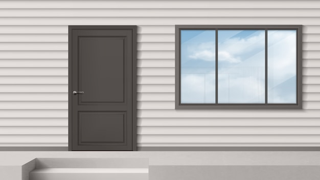Fasada domu z szarymi drzwiami, oknem, ścianą boczną