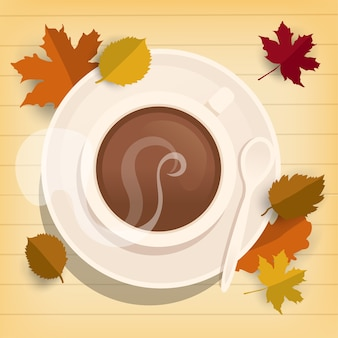Filiżanka kawy na drewnianym stole z jesień liśćmi, odgórny widok