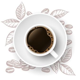Filiżanka kawy z liśćmi i ziarnami