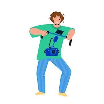 Filmowiec nakręć wideo z wektora aparatu cyfrowego. filmowiec nagrywający film z profesjonalnym urządzeniem elektronicznym. klip do nagrywania operatora postaci z elektronicznym gadżetem z płaską ilustracją kreskówki