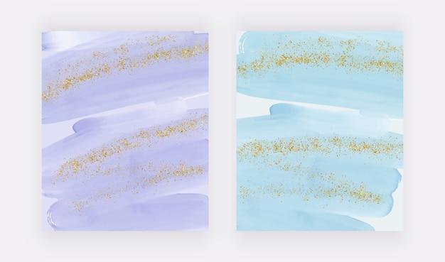Fioletowe i niebieskie pociągnięcia pędzla akwarela i złote błyszczące brokatowe konfetti tła.