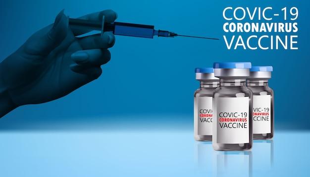 Fiolka zawierająca jedną butelkę szczepionki przeciwko koronawirusowi covid ze strzykawką trzymającą dłoń