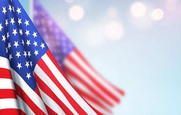 Flaga ameryki macha przed rozmytym niebem