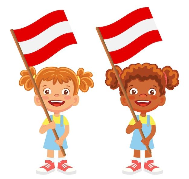 Flaga austrii w ręku. dzieci trzymając flagę. flaga narodowa austrii wektor