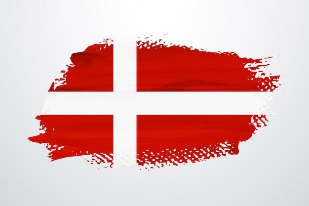 Flaga danii pędzlem farby