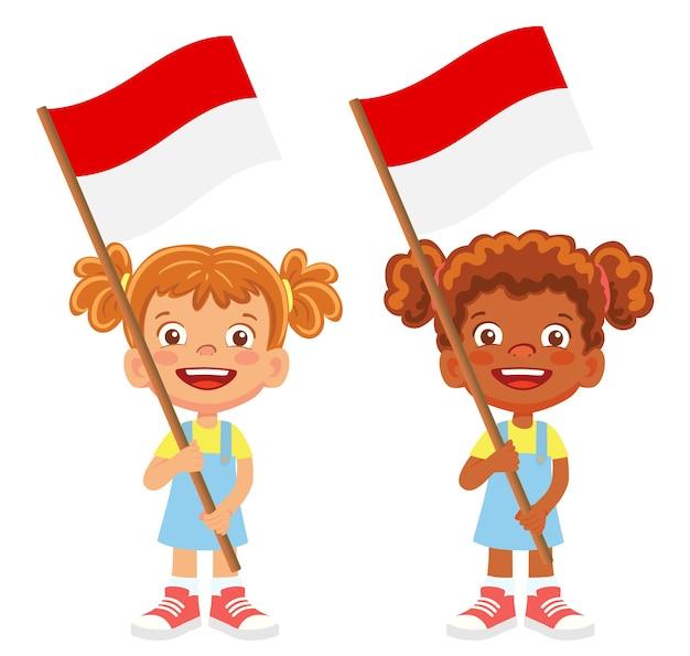 Flaga indonezji w ręku. dzieci trzymając flagę. flaga narodowa indonezji wektor