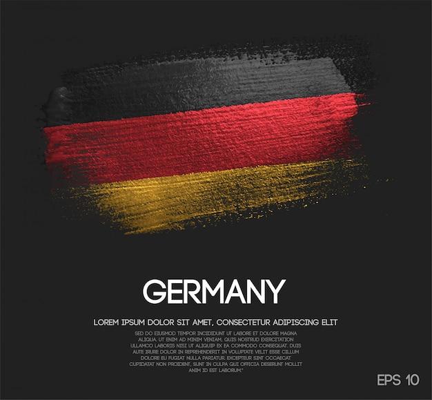 Flaga niemiec z błyszczącą farbą pędzlem blasku