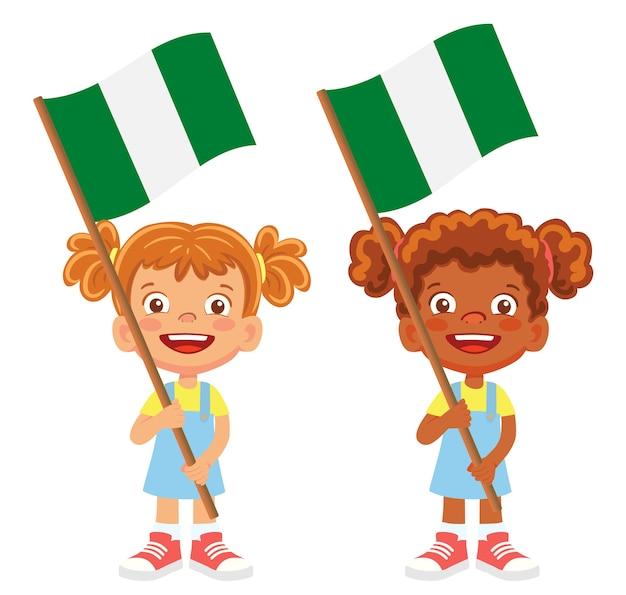 Flaga nigerii w ręku. dzieci trzymając flagę. flaga narodowa wektor nigerii
