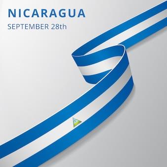 Flaga nikaragui. 28 września. ilustracja wektorowa. falista wstążka na szarym tle. dzień niepodległości. symbol narodowy.