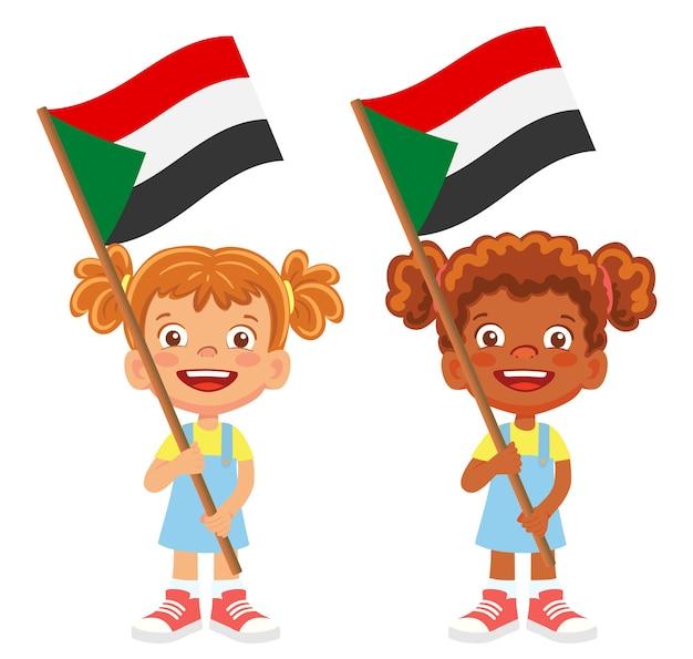 Flaga sudanu w dłoni. dzieci trzymając flagę. flaga narodowa sudanu wektor