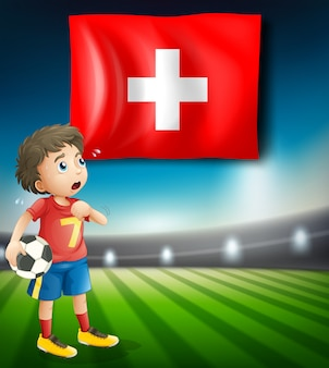 Flaga szwajcarii i piłkarz