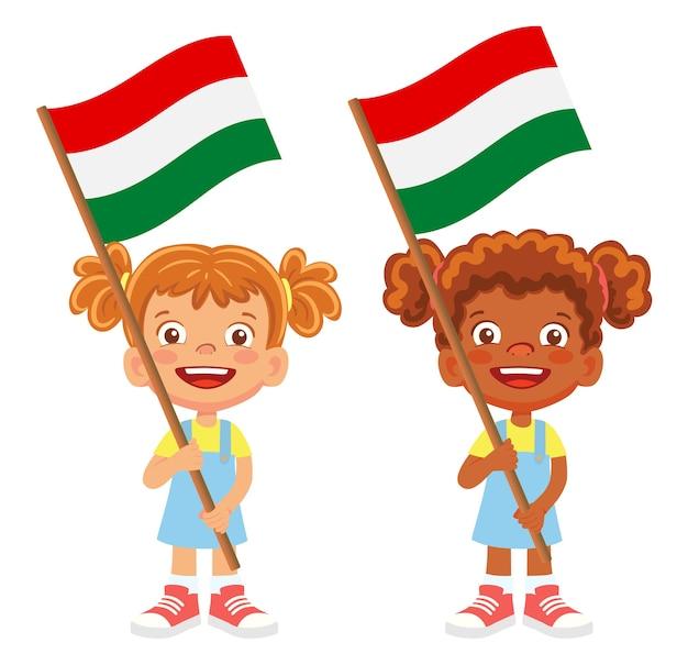 Flaga węgier w ręku. dzieci trzymając flagę. flaga narodowa węgier wektor