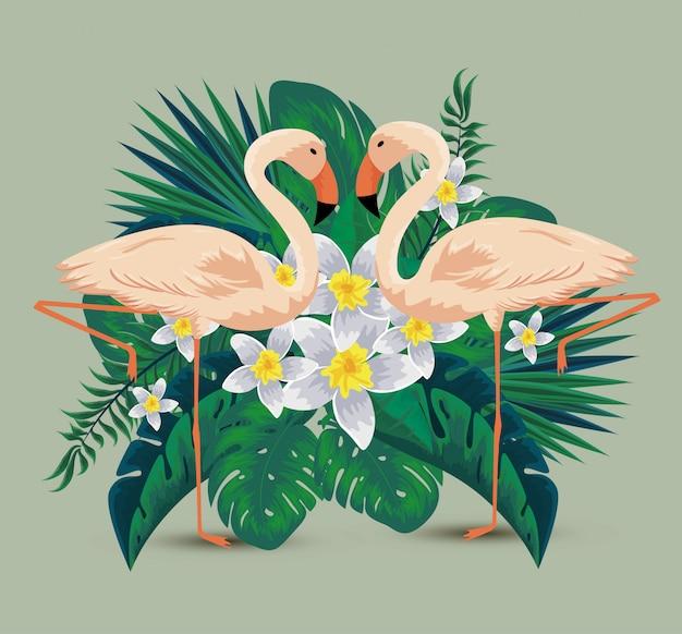 Flamingi z tropikalnymi kwiatami rośliny i liście