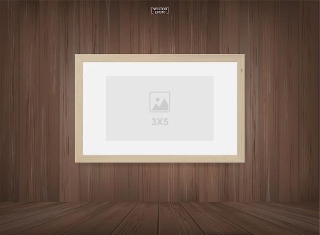 Fotografii rama w drewnianym pokoju przestrzeni tle.