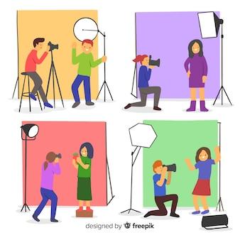 Fotografowie pracujący z aparatem