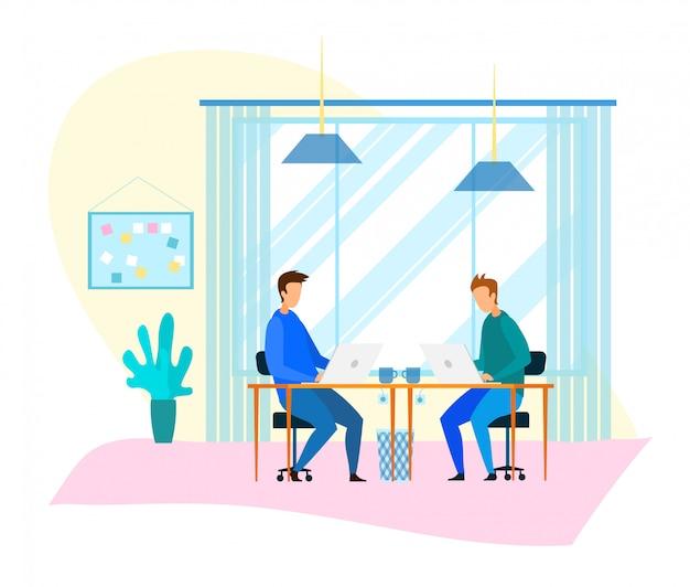 Freelancerzy pracują na komputerze w modern coworking office
