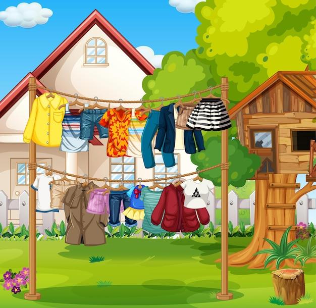 Front domu z ubraniami wiszącymi na sznurkach
