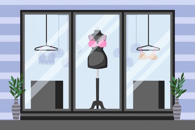 Frontowa gabloty wystawowej bielizny witryna sklepowa, ilustracja. manekin z koronkowym stanikiem, cienkie ubrania na wieszaku. wazony przy oknach
