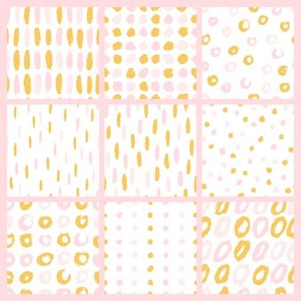 Gaj pędzla w złotym tuszu. zestaw minimalistycznych wzorów bez szwu
