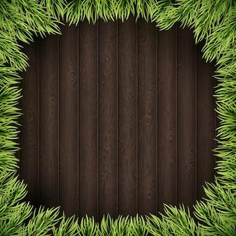 Gałęzie choinkowe na podłoże drewniane.