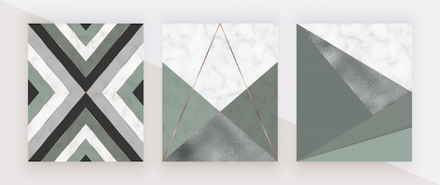 Geometryczny wzór z trójkątnymi kształtami zieleni i folii oraz złotymi liniami na marmurowej fakturze.