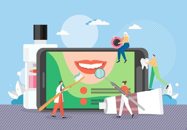Gigantyczny telefon komórkowy z aplikacją dentystyczną.