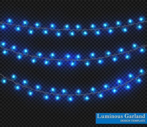 Girlanda w kolorze niebieskim, ozdoby świąteczne. świecące lampki choinkowe na przezroczystym tle.