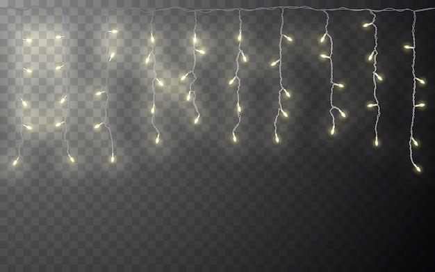 Girlanda xmas color, ozdoby świąteczne. rozjarzony efekt przezroczystego efektu na ciemnym tle.
