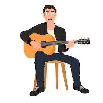 Gitarzysta śpiewa piosenkę i gra na gitarze akustycznej.
