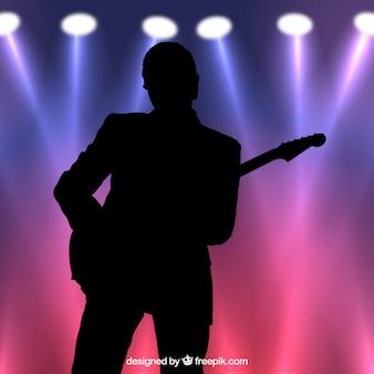 Gitarzysta sylwetka pod? wietlany