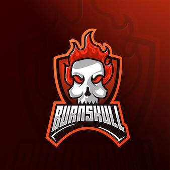 Głowa czaszki z logo e-sportu maskotki z ognistymi włosami