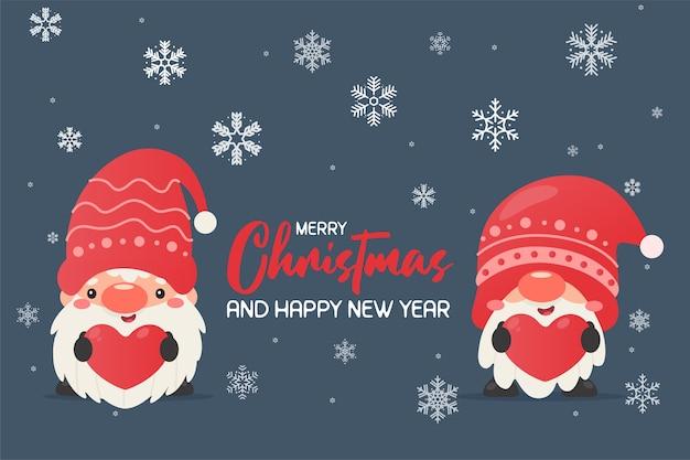 Gnom w świątecznej czapce trzyma etykietę z czerwonym sercem śnieżna zima na boże narodzenie