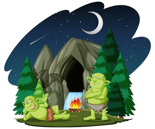 Goblin lub troll z kamienną jaskinią stylu kreskówka na białym tle
