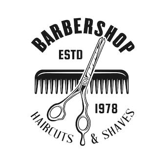 Godło fryzjera z nożyczkami i grzebieniem do włosów na białym tle