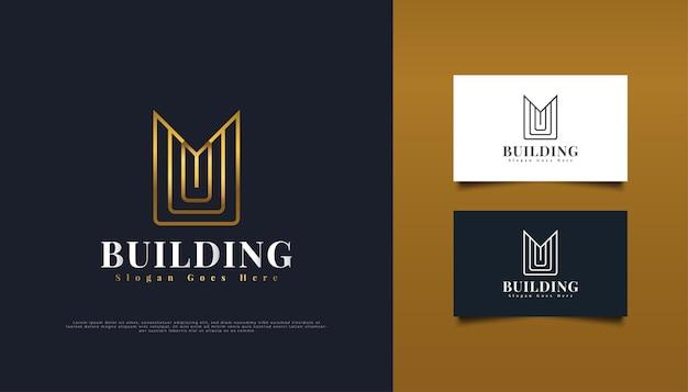 Gold real estate logo design z literą m w minimalistycznej koncepcji.