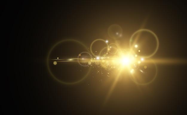 Gold sparkles, magiczny, jasny efekt świetlny na przezroczystym tle. złoty pył.