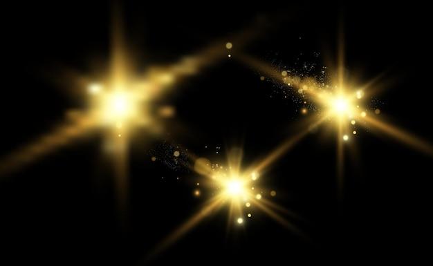 Gold sparkles, magiczny, jasny efekt świetlny na przezroczystym tle.