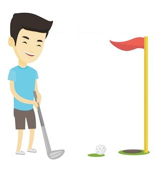 Golfista uderza piłkę.