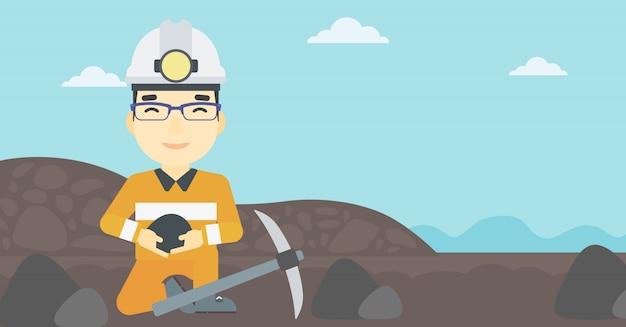 Górnik trzyma węgiel w ręce ilustracji wektorowych.