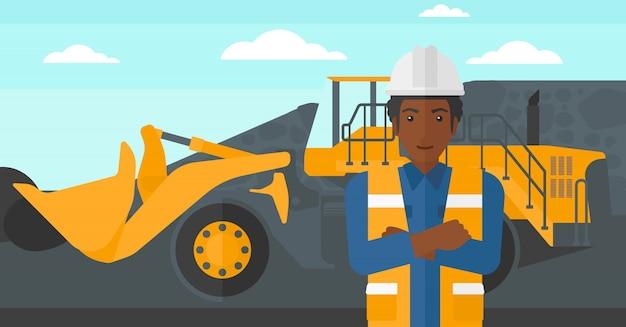 Górnik z włączonym sprzętem górniczym